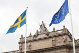 The flags are flying on Riksplan in front of the East Wing of the Riksdag