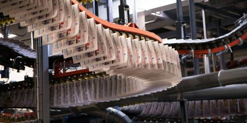 Newspapers hanging on a printing press at a printing office.