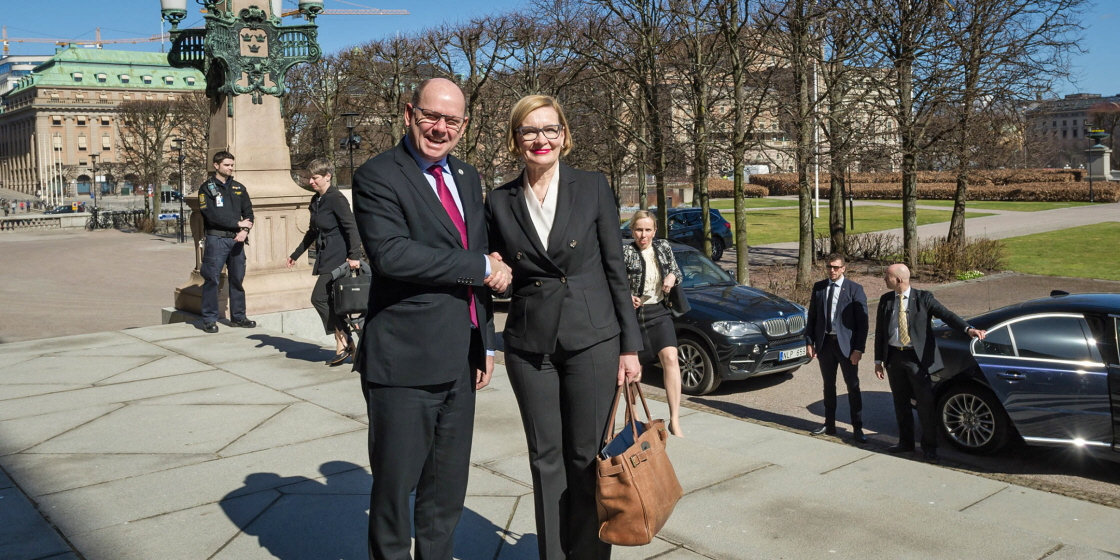 The Speakers shaking hands outside the Riksdag